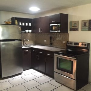 Cute kitchen full equipped  with granite counter top, full stove, micro and refg