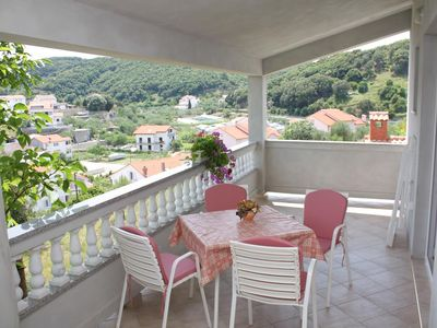 Photo for Two bedroom apartment with terrace and sea view Supetarska Draga - Donja (Rab)