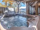 Blissful bubbles - The expansive wraparound deck includes a hot tub where you can luxuriate after a day of hiking, golfing, or skiing.