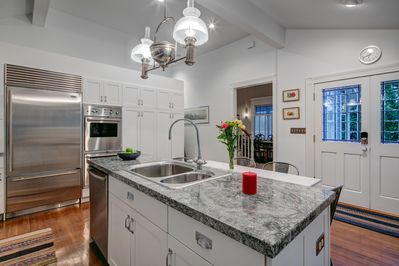 Huge, well equipped open kitchen with breakfast seating.