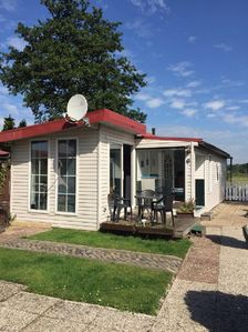"""Photo for Nature PUR Holiday house """"Waterloo"""" with private boat dock"""