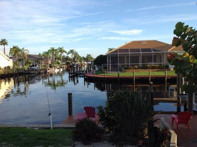View out back of house. Intersecting canals. 5 min to Gulf of Mexico