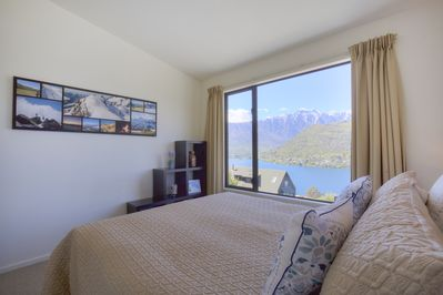 Upstairs guest bedroom 1 with views of the lake and mountains
