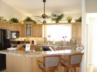 Upgraded natural Maple and Granite kitchen.