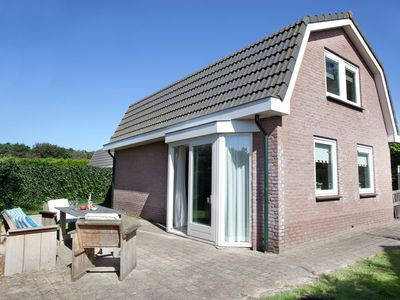 Photo for Detached bungalow with a big lovely garden and WiFi, in a park by the North Sea