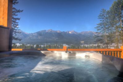 A private hot tub with mountain views
