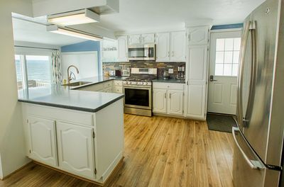 Clean, crisp, well-appointed kitchen with fantastic lake views