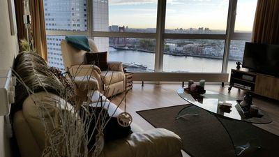 Living Room /Smart 4K Ultra HD TV/ River Maas/ Willems Bridge