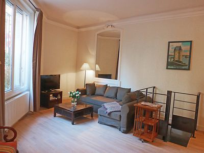 Cosy and comfortable seating area with large cable TV.