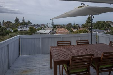 Upstairs deck with sea and Mount views