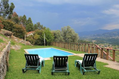 Pool area with breathtaking view over the valey