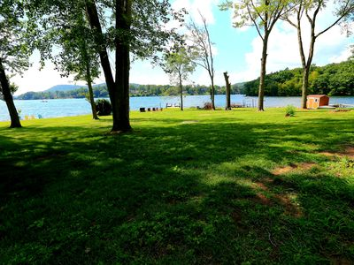 Level, direct lakefront, expansive western views, beach on Candlewood Lake