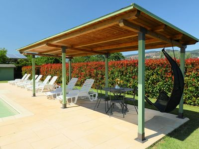 Photo for Lovely apartment in villa for 6 guests with WIFI, pool, A/C, TV, pets allowed and parking