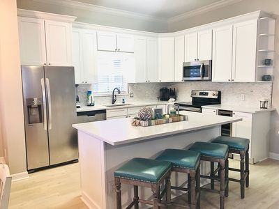 BRAND NEW KITCHEN! New flooring, built-in wine chiller/cooler, quartz counter tops and backsplash, stainless steel appliances, updated cabinets, new kitchen wear, new bar stools, the list goes on and on!!!