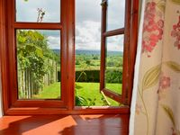 Very attractive rural building both inside and out, full of light with superb views.
