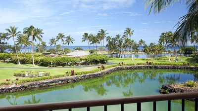 View from living room Lanai to fish pond, ocean & private pool