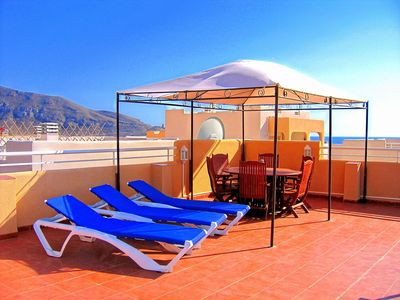 Photo for Modern Tourist Board approved apartment, close to beach with pools and sea view