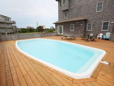 14' x 32' Private swimming pool with spacious deck and ample pool furniture