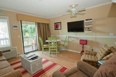 Ocean Dunes 320- Living Area with oceanfront view. - Dinette table, flat Screen TV, balcony with oceanview