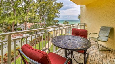 Photo for Amazing Sunsets and Gulf Water Views - Updated kitchen and baths spacious layout. Short Walk to restaurants