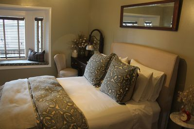 Queen size bed with featherbed in the winter.