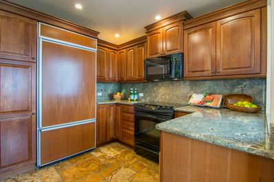 The kitchen is very complete and equipped for cooking a full meal.