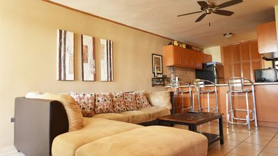 Living Room with cable TV,  A/C, ceiling fans, exit to balcony