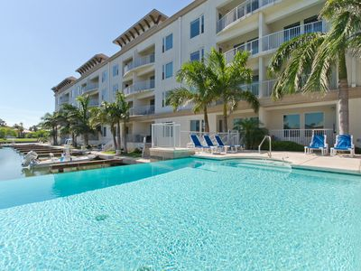 Boat Slip with condo! Channel Front, Infinity Pool, Hot Tub! Just a few minutes walk to the beach!