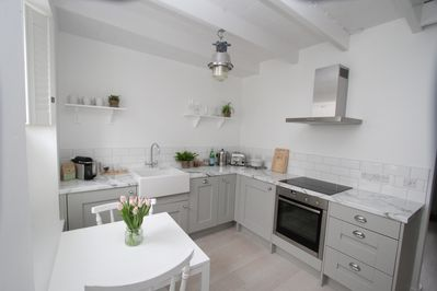 Fully equipped contemporary kitchen with butler sink & vintage lighting