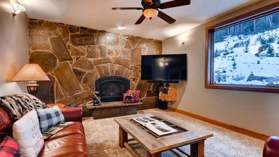 Main floor living area with fireplace and nice views.