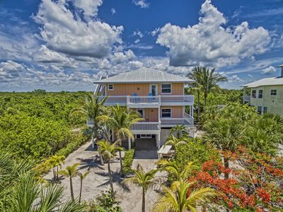 Photo for Captivation - Sunrise-to-sunset views–walk to beach– 2 golf carts, bikes, pool