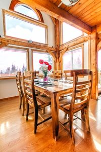 Dining Area with surrounding views to meadows, forest and mountains!
