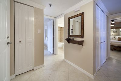 A large entrance foyer leads directly to the open-floor-plan living /dining area