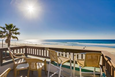 Beachfront bungalow with amazing views from condo and private rooftop deck.