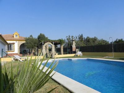 Photo for nice quiet house with private pool, large garden and barbecue, for 7 persons, at the pineforest, 5min to the beach, with WiFi