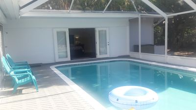Photo for Beautiful Vacation Home w/Heated Salt Water pool near the beach & shopping mall!
