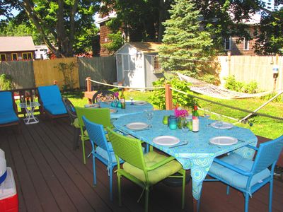 Fabulous back deck with 2 dining tables, umbrella (not pictured), 2 loungers, gas grill