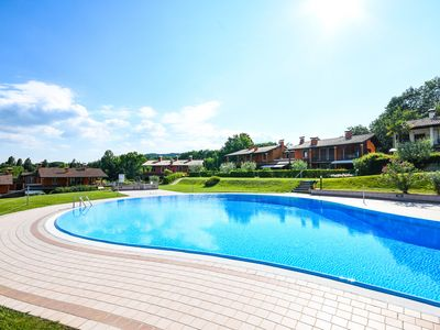Photo for Nice apartment with lake view garden and terrasse in resort with large pool, close to the lake