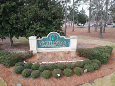 Myrtlewood sign to entrance of condos