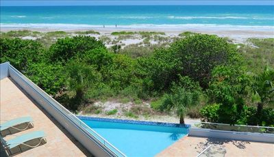 Photo for 4 Bedroom / 3 Bath Beachfront pool home w/ walls of glass looking out to the Gulf