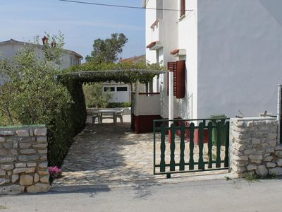 Photo for Two bedroom apartment with terrace Povljana, Pag (A-6468-b)