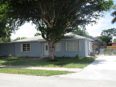 Photo for Large pool home/Steps from the beach/Pets welcome