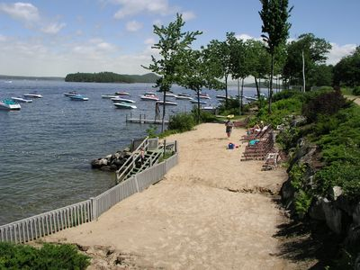 Sandy beach and waterfront with lounge chairs at Samoset.