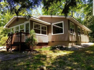 Photo for Cozy Cottage on a Private Wooded Lot, Close to Lake Charlevoix!