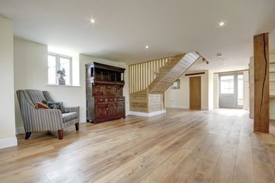 The original wooden beams are accompanied by beautiful antique furniture and art