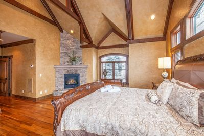 Adirondack Master Bedroom with Stone Fireplace and Fine Furnishings