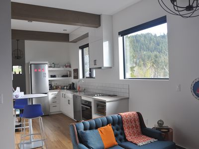Photo for Full apartment with private entry and garage parking right in Rossland.