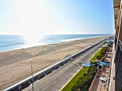 Photo for Spacious, attractive 2 bedroom luxury oceanfront condo with free WiFi, fun tropical decor, and a breathtaking ocean view located downtown on the boardwalk just steps to the beach!