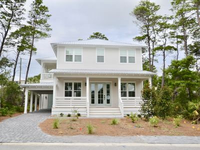 Photo for Happy Ours, 4 BR/4BA Beach House, walk to beach and dining, c.pool, sleeps 12