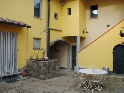 Photo for A comfortable apartment in the Tuscan countryside next to the city center.